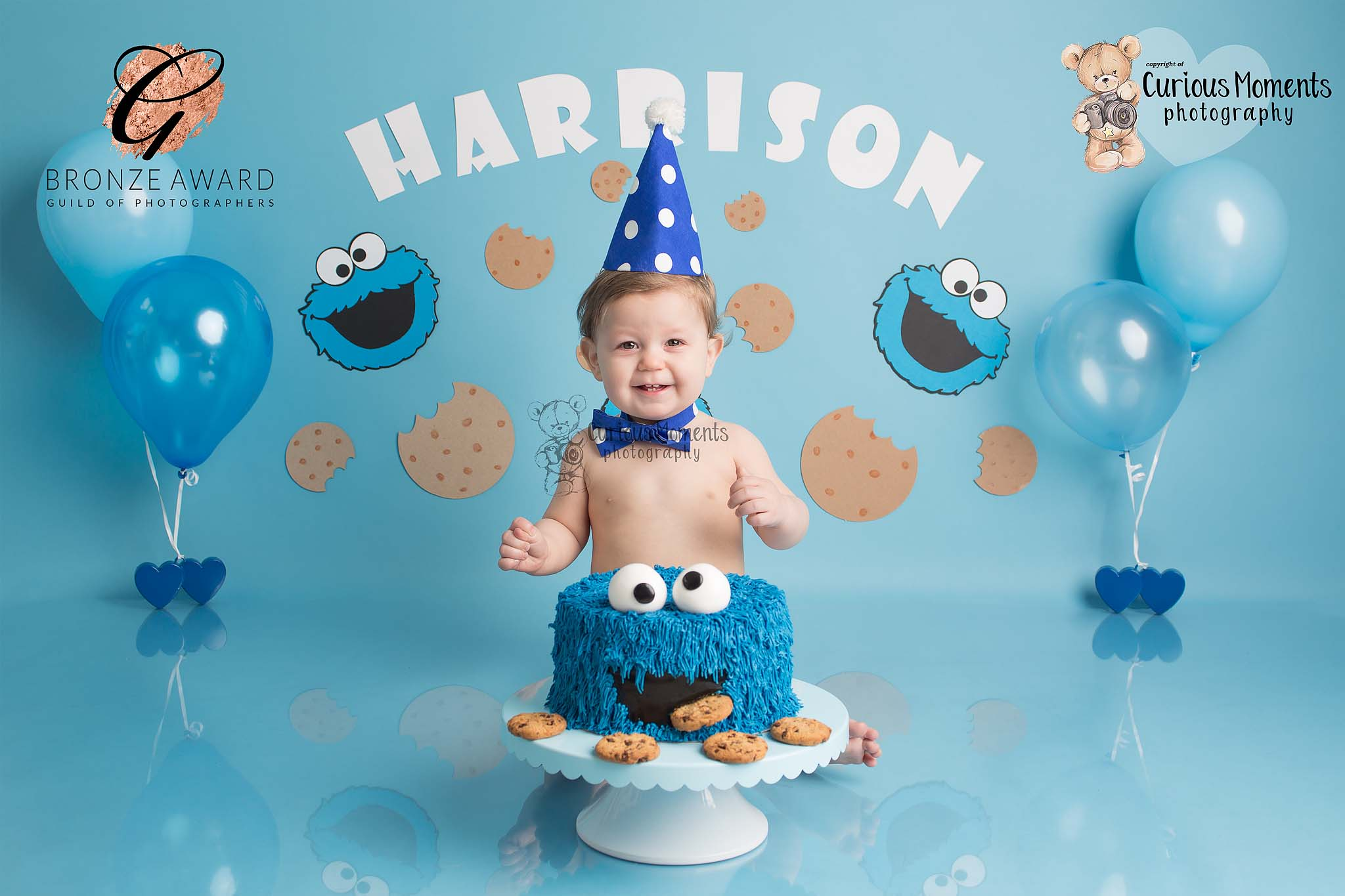 Birthady boy enjoying himself with a cookie monster inspired cake smash with carmarthen photographer