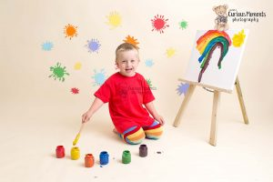 Boy celebrating his birthday with a paint splat photo shoot Photographer Carmarthenshire