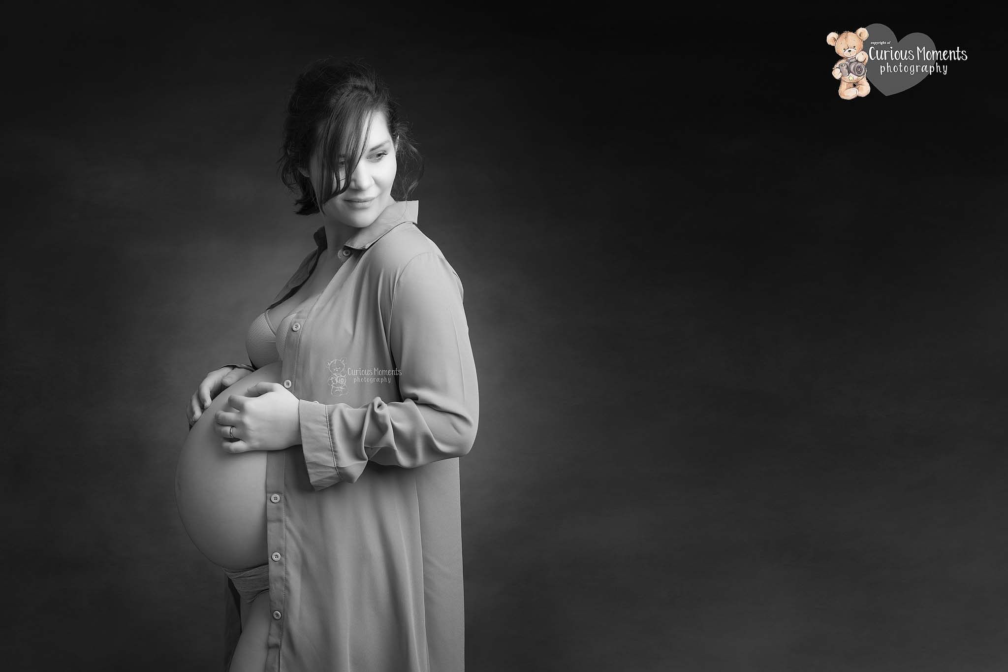 black and white image of pregnancy photoshoot with bump showing in studio by Maternity Photographer Carmarthen