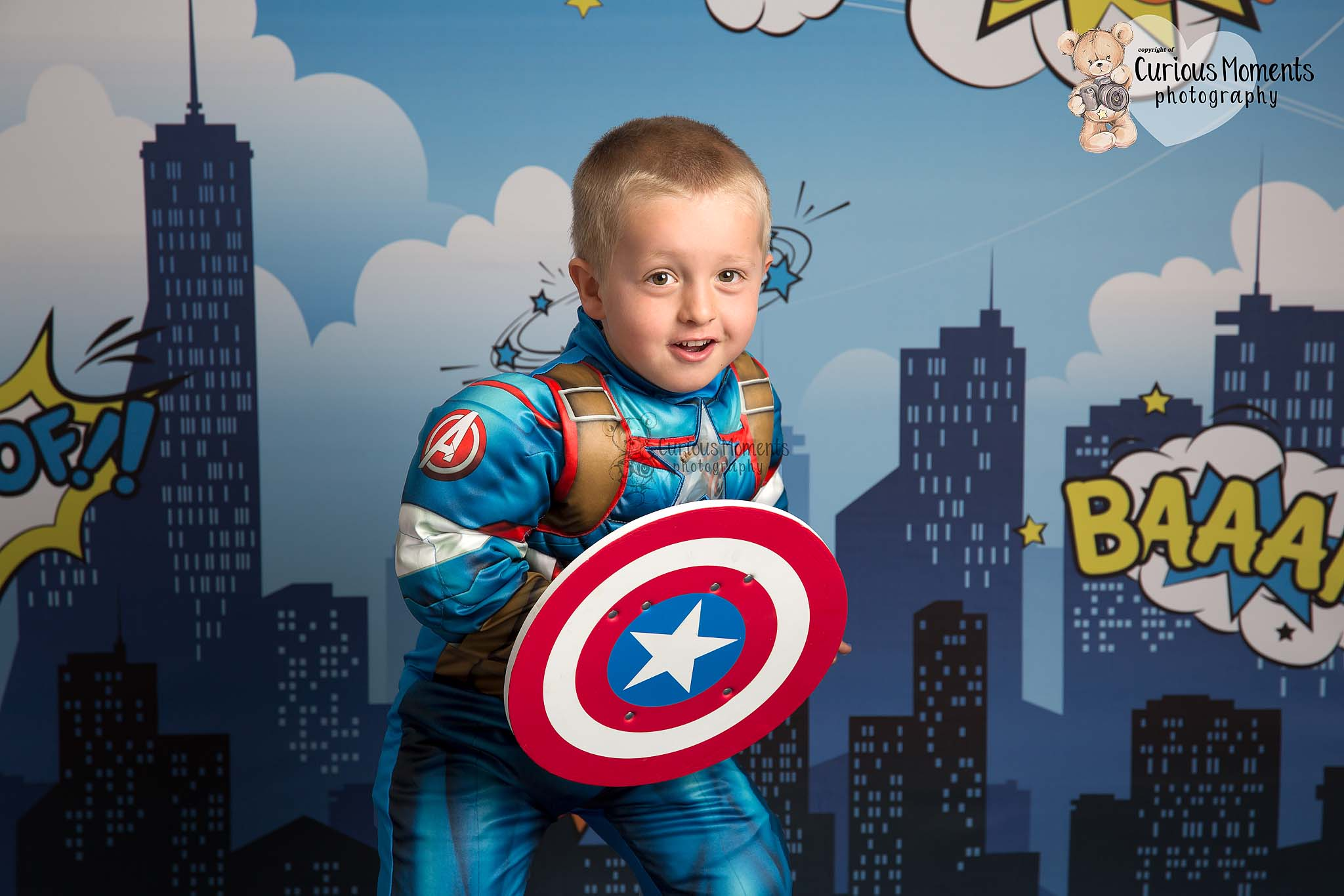 Carmartheshire Child photographer take image of young boy as captain america on a superheor themebed background