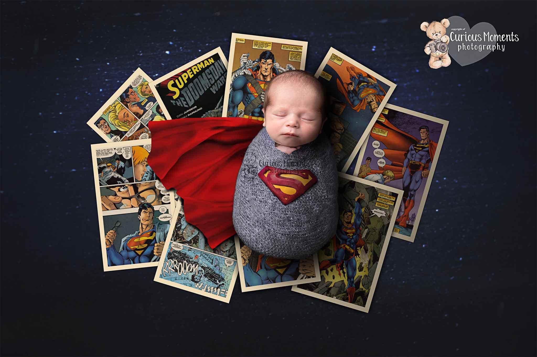 Newborn baby as superman with retro comics