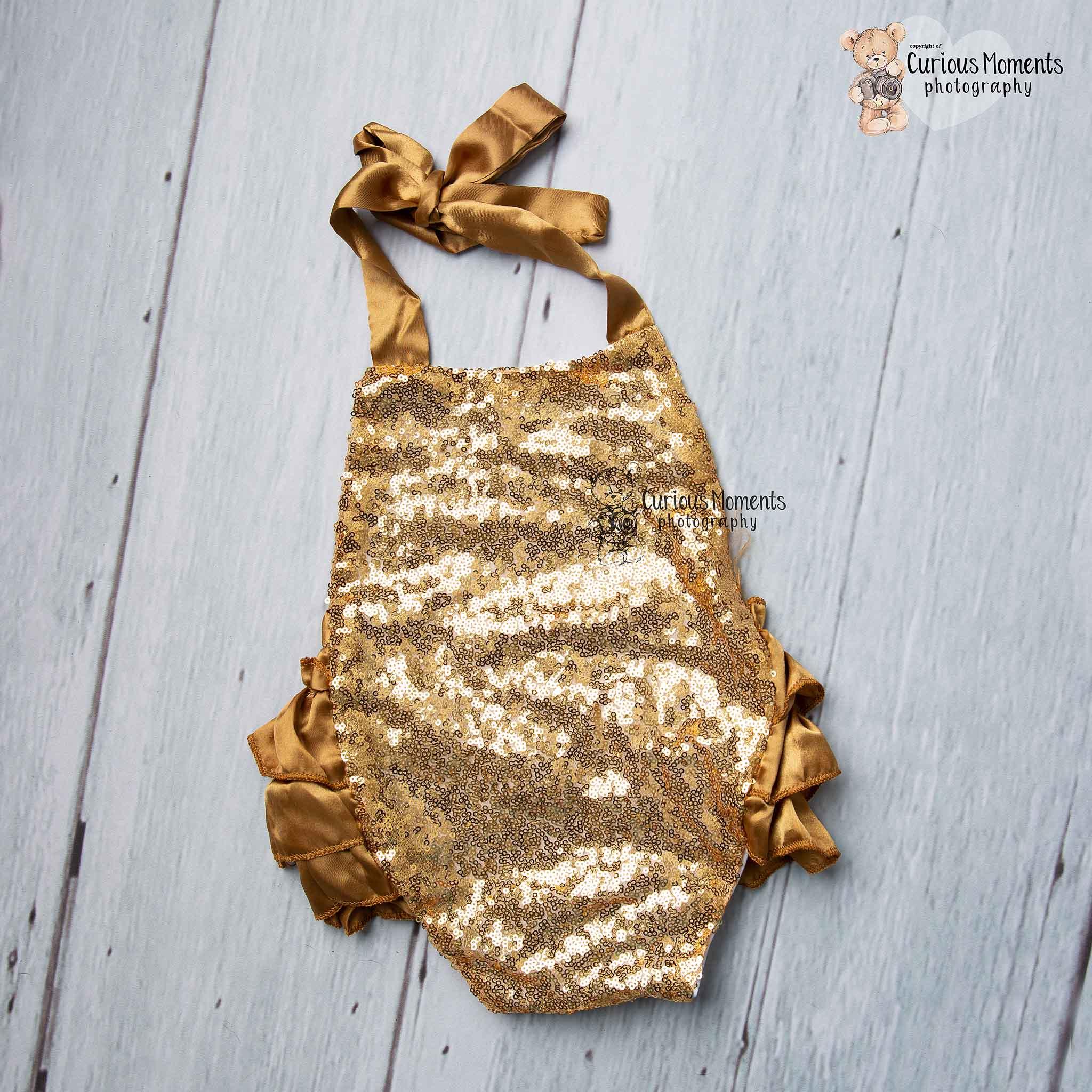 Gold sequin romper for ckae smash whitland