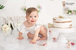 White floral cake smash with st clears photographer